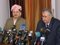 Iraqi president Jalal Talabani, right, and president of Iraqi Kurdistan Massoud Barzani address media.