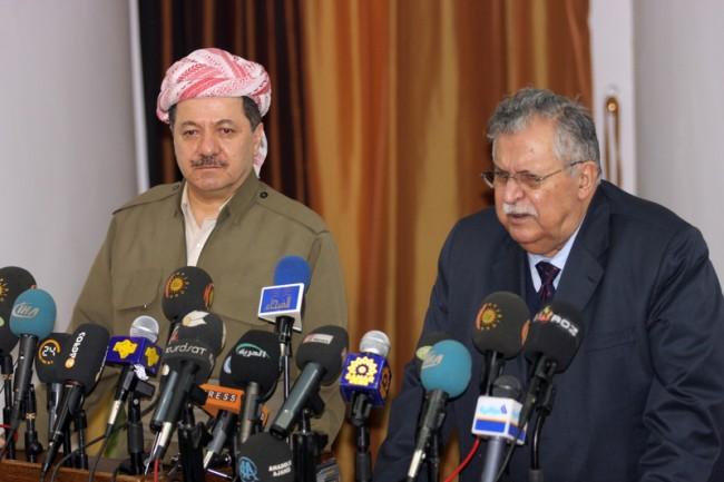 Iraqi president Jalal Talabani, right, and president of Iraqi Kurdistan Massoud Barzani address media.