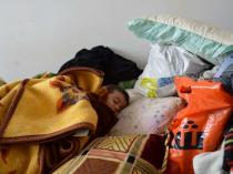 A refugee child sleeps in Al Qaim in western Anbar. UNHCR/N.Prokopchuk