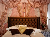 A bedroom in a luxury hotel.