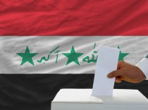 An Iraqi voter cast his vote during elections.