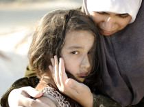 A Palestinian mother comforts her child. Poverty is rampant in the Palestinian territories, especially Gaza.