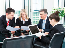 Business - meeting in an office, the businesspeople are discussi