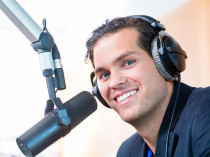 Presenter or host in radio station hosting show for radio live i