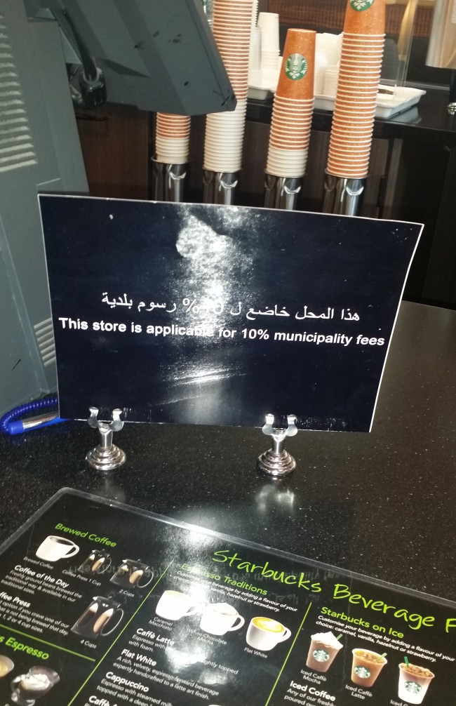 A notice about the new 10 percent municipality fee inside the Starbucks outlet along Sheikh Zayed Road, Dubai