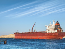 Big Red Oil Tanker Passes Through The Suez Canal