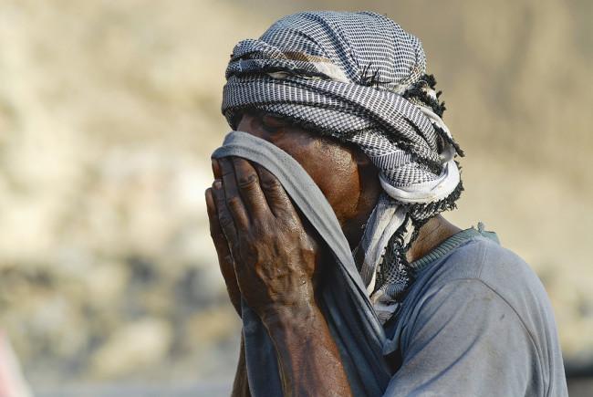 Portrait of unidentified man wearing traditional head scarf in A