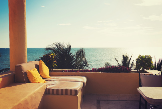 vacation, home and travel concept - sea view from balcony of hom