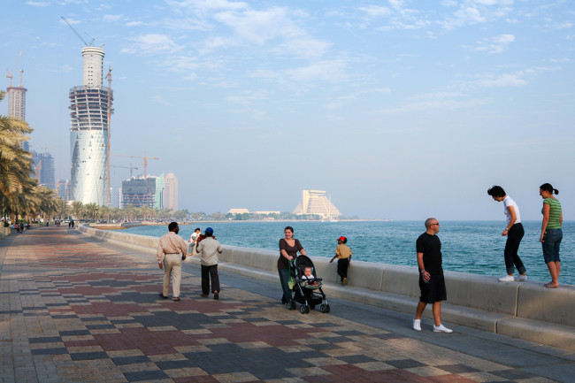 DOHA, QATAR - NOVEMBER 18, 2007: Expats and local citizens enjoy