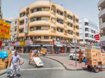 DUBAI, UAE - MARCH 31: People on the street of Deira area in Dub