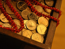 Charity during holy month of Ramadan. Close up of UAE Dirham coi